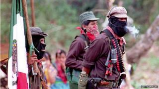 Subcomandante Marcos (right) waits for the arrival of Mexican opposition presidential candidate Cuauhtemoc Cardenas on 15 May 1994