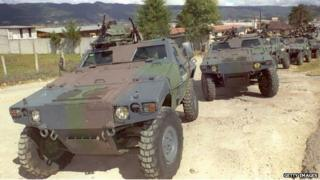 Mexican Army vehicles patrol the outskirts of San Cristobal de las Casas on 19 December 1994