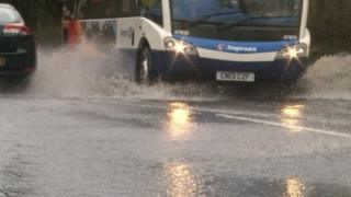 Bus going through flood water