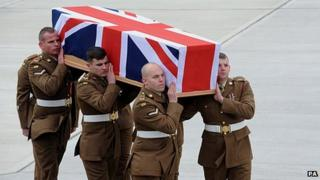 Six soldier carry a coffin draped in the Union Flag