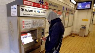 Passenger buys ticket