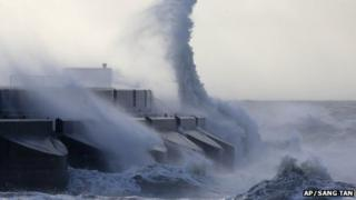 Waves batter into the sea wall of a marina in Brighton on 28 October 2013