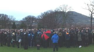 Open air service being held at a cemetery in Craigmillar