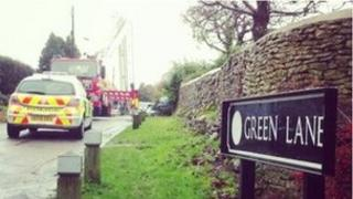 A fire engine and police car at the scene on Green Lane