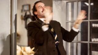 John Cleese as Basil Fawlty, sitcom Fawlty Towers