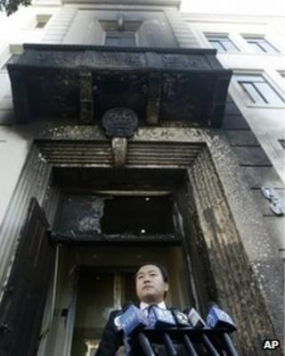 Wang Chuan, spokesperson for the Chinese Consulate, speaks outside of the damaged entrance to the consulate in San Francisco on 2 January 2014