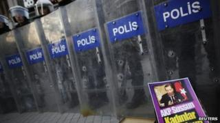 Police use riot shields during an anti-government protest in Istanbul, 5 January