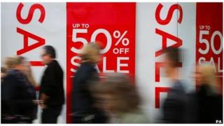 Discount signs and shoppers