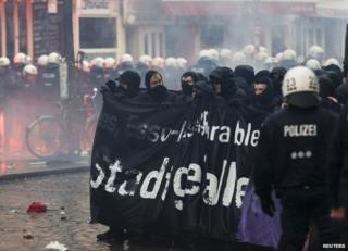 German riot police face protesters near the Rote Flora centre in Hamburg, 21 December