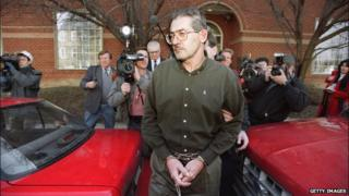 Aldrich Ames in front of a courthouse