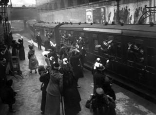 Waving goodbye to London at Victoria station
