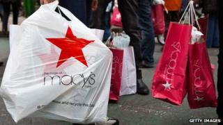 Macy's shopping bags and people walking
