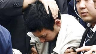 Rape suspect Yuta Sugimoto is captured by police, in Kawasaki, Japan, on 9 January 2014