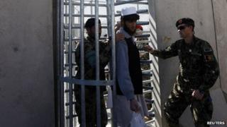 A prisoner is freed after a ceremony handing over Bagram prison to the Afghan authorities in March 2013