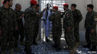 Prisoner awaits release during ceremony handing over Bagram prison to Afghan authorities. March 2013