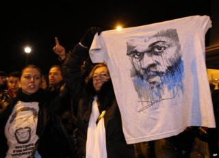 Supporters wave a tee-shirt of Dieudonne M'bala M'bala in Nantes, 9 January