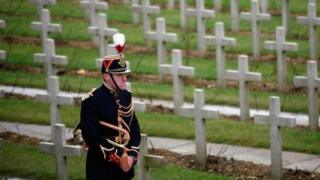 A French soldier stands in front of World War One graves in Douaumont, France.