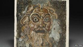 "A comic mask mosaic, one of the exhibits in ""Life and death in Pompeii and Herculaneum"