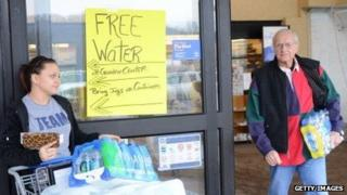 With their drinking water unsafe, West Virginians pick up free water at a local store on January 10, 2014.