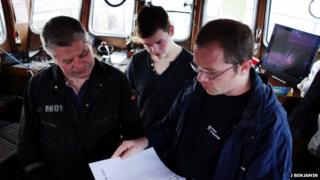 Fisherman and diver Andy Holbrow and archaeologist