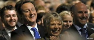 David Cameron among the crowd at the party conference watching a Boris Johnson speech