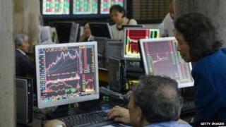 People looking at stocks in Shanghai
