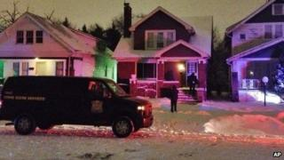 A crime scene vehicle is parked outside a house in Detroit 16 January 2014
