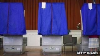 A voter cast a ballot in a voting booth in Philadelphia, Pennsylvania, on 24 April, 2012
