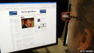 A woman reads the New York Times online.