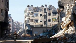 Rubble of the Harasta area of eastern al-Ghouta, near Damascus, on 24 December 2013