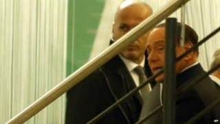 Silvio Berlusconi at Democratic Party HQ on 18 Jan