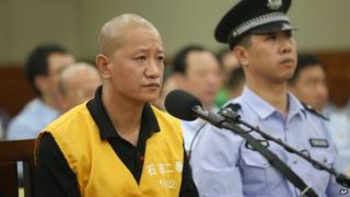 File photo: Lu Yueting stands trial at the Shijiazhuang Intermediate People's Court in Shijiazhuang, capital of north China's Hebei Province, 30 July 2013