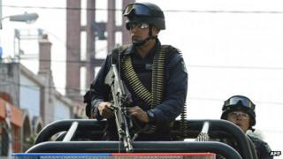 Mexican soldiers patrol the streets of Apatzingan, in Michoacan State, Mexico (January 2014)