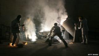 Men making uranium hexafluoride gas at the Isfahan uranium conversion facility (March 2005)
