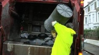 Binman throwing rubbish on to lorry