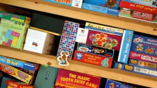 Shelves stocked with board games and toys.