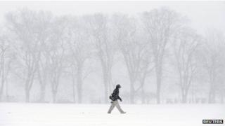 A pedestrian braves the elements during a winter storm in Halifax, Nova Scotia, on 22 January 2014