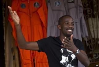 Mandla Maseko with his spacesuits