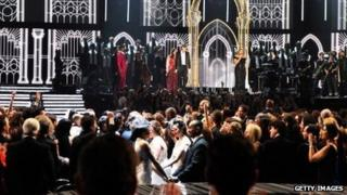Thirty-three couples are married by Queen Latifah during the Grammy Awards show on January 26, 2014.