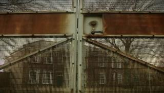 Rusty gates shut in front of the closes detention centre at Medomsley