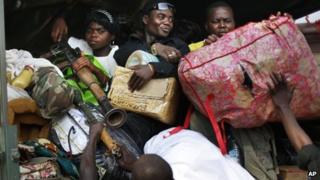 Seleka Muslim militias evacuate the Camp de Roux downtown Bangui, Central African Republic, Monday Jan. 27, 2014, to relocate and join other Selekas at the PK11 camp.