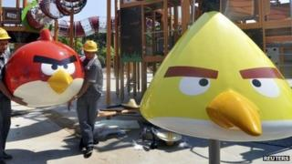 Workers install a recreation facility at an Angry Birds theme park in Haining, Zhejiang province 10 July 2013