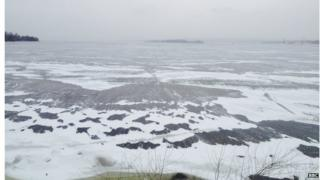 The view across the frozen Dnieper river, while entering Zaporizhya on a particularly cold, bleak day.