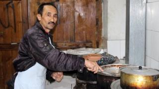 Ibrahim, the chef at Kabul's popular 'Sufi' restaurant at work in the kitchen