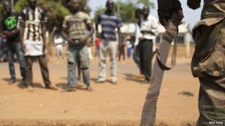 A French peacekeeping soldier holds a confiscated machete in the district of Combattant near the airport of the capital, Bangui, in the Central African Republic - 29 January 2014