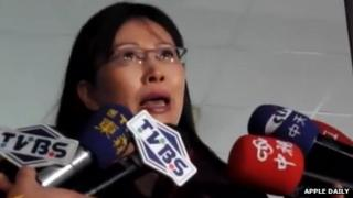 Wang Kuei-fen speaks to reporters