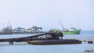 Barge being loaded with coal in Santa Marta, Colombia