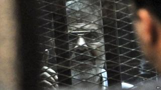 Mohammad Morsi in court on 28 Jan 2014