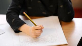 Child writing lines