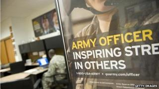 An Army poster hangs in an Army recruiting station in Boston, Massachusetts, on 21 October 2009